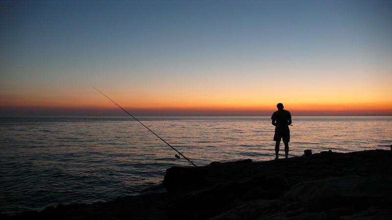 canva-person-fishing-during-sunset-MADGyMLoPgo