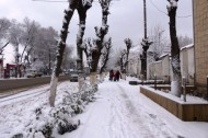The heavy snow fell after a long-lasting rain in the city of Osh.