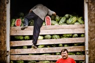 Migrants unload truck with watermelons on Warsaw highway. Moscow, 2007<br />