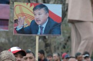 Release of MP Akhmatbek Keldibekov (on the banner) under house arrest is among the opposition's requirements. He is charged with corruption and abuse of power.