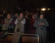 The theater was full, and the audience gave a standing ovation at the end of the performance.