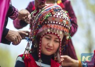 Haznihan Turdi is proud that she makes the best Kalak, a traditional headwear for Kyrgyz women, in her village.<br />