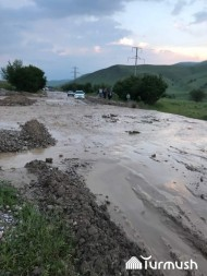 Six houses and irrigation canal have been flooded in Kyzyl-Tuu village. The natural disaster caused traffic problems as well.
