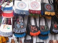 Traditional ornaments and embroidery are widely used in modern items, such as bags and wallets usually made of felt by hand.