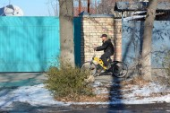 The absence of bikeways in Bishkek force the bike riders to cycle on sidewalks.