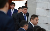 President Sooronbai Jeenbekov is entering the plenary session room of the Parliament to officiate the swear-in ceremony.