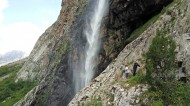 The waterfall is seen from a distance. It is 60 meters high, which makes it one of the biggest waterfalls in Kyrgyzstan.
